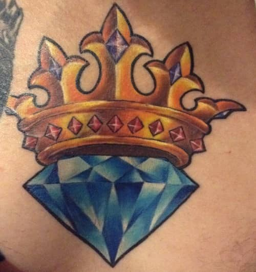 tattoo by Starr, blue diamond with crown